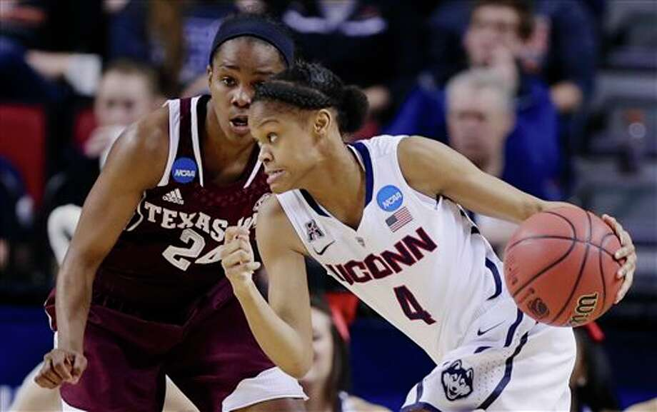 Connecticut's Moriah  Jefferson (4) drives past Texas A&M's Jordan Jones (24) during the  second half of a regional final game in the NCAA college basketball  tournament in Lincoln, Neb., Monday, March 31, 2014. (AP Photo/Nati  Harnik)