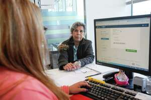 Health insurance applicant Maria del Carmen Cervantes receives help signing up Monday in Houston.