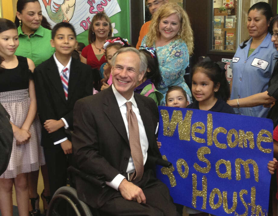 Attorney General Greg Abbott, GOP candidate for governor, greets children at Sam Houston Elementary School in Weslaco before unveiling the first part of his education plan. Photo: Aaron M. Nelson / San Antonio Express-News / San Antonio Express-News
