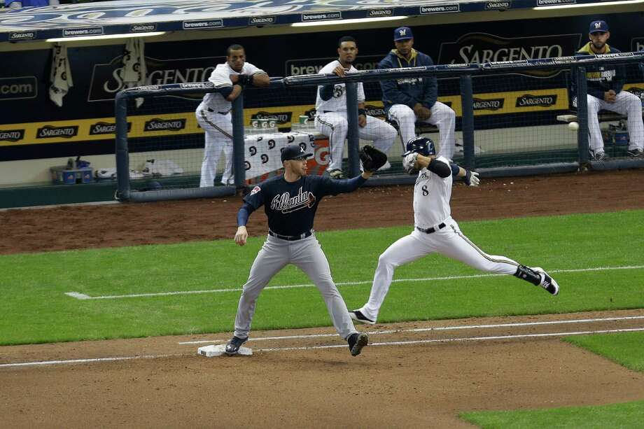 MILWAUKEE, WI - MARCH 31: Ryan Braun #8 of the Milwaukee Brewers runs to first base in the bottom of the sixth inning against the Atlanta Braves Opening Day at Miller Park on March 31, 2014 in Milwaukee, Wisconsin. Braun was called safe at first but the play was over turned by instant replay.  (Photo by Mike McGinnis/Getty Images) ORG XMIT: 477579561 Photo: Mike McGinnis / 2014 Getty Images