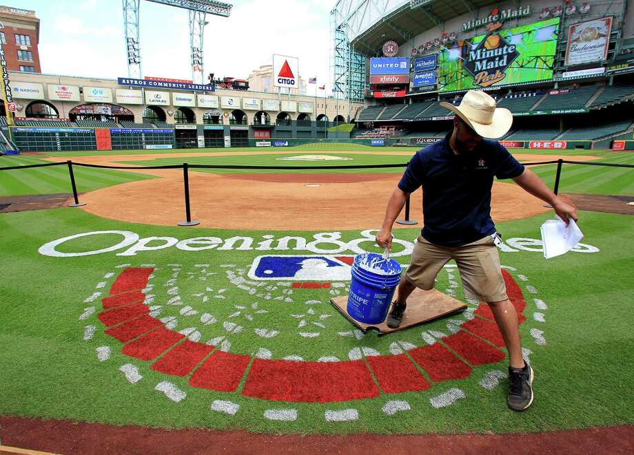 Minute Maid Park grounds crew member,  James Vaughn, works on painting the Opening Series logo behind home plate, Monday, March 31, 2014, in Houston. Houston Astros opening day is Tuesday. ( Karen Warren / Houston Chronicle  ) Photo: Karen Warren, Staff / © 2014 Houston Chronicle