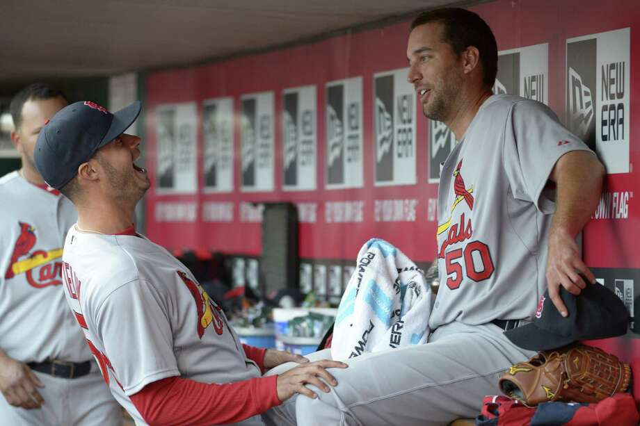 Cardinals starter Adam Wainwright (right) handed the Reds their first Opening Day shutout since 1953. Photo: Michael Keating / Associated Press / FR170759 AP