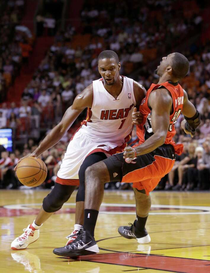 Miami Heat center Chris Bosh (1) is fouled by Toronto Raptors forward Patrick Patterson as he goes up for a shot during the first half of an NBA basketball game, Monday, March 31, 2014 in Miami. (AP Photo/Wilfredo Lee) ORG XMIT: AAA105 Photo: Wilfredo Lee / AP