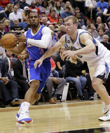 Clippers guard Chris Paul (left) drives on Timberwolves forward Robbie Hummel during Los Angeles' 114-104 victory at the Target Center. Photo: Ann Heisenfelt / Associated Press / FR13069 AP