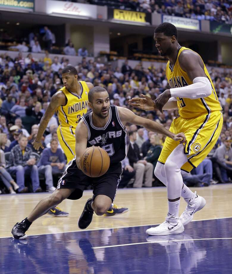 San Antonio's Tony Parker drives around Roy Hibbert in the second half of the Spurs' 18th straight win. Parker finished with a game-high 22 points. Photo: Michael Conroy, Associated Press