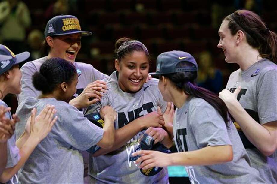 Connecticut players including  Stefanie Dolson, top left, and Breanna Stewart, right, celebrate with  Kaleena Mosqueda-Lewis, center, after beating Texas A&M, 69-54 in  the Lincoln regional final game in the NCAA college basketball  tournament in Lincoln, Neb., Monday, March 31, 2014. Connecticut  advances to the final four. (AP Photo/Nati Harnik)
