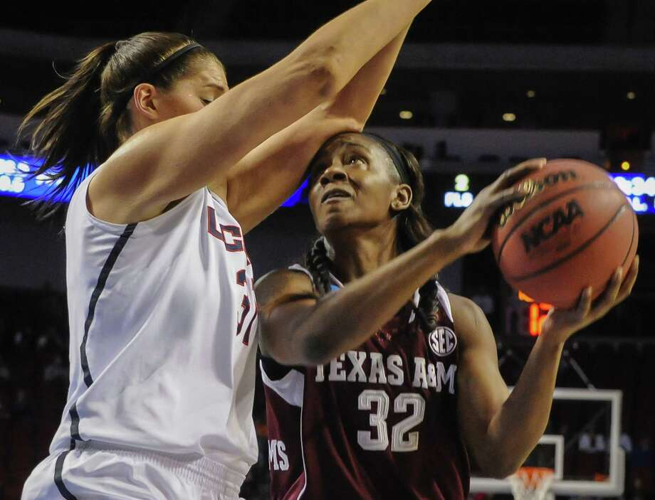 A&M's Tavarsha Scott-Williams tries to maneuver around UConn's Stefanie Dolson in the first half. Dolson finished with 14 points and 10 rebounds. Photo: Dave Weaver / Associated Press / FR67562 AP