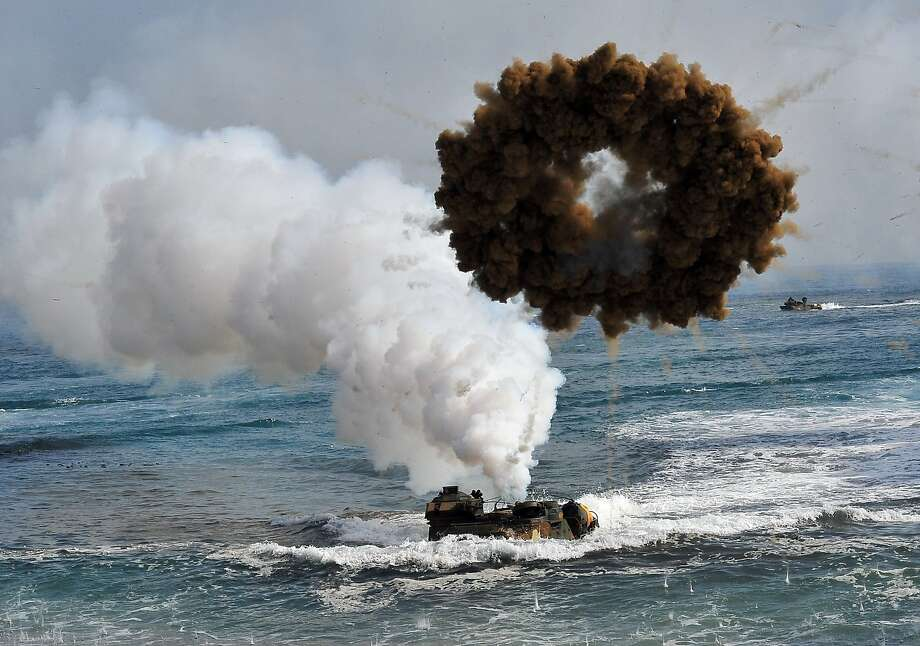 """TOPSHOTS South Korean Marine amphibious assault vehicles land on the seashore during a joint landing operation by US and South Korean Marines in Pohang, 270 kms southeast of Seoul, on March 31, 2014. North Korea announced a live-fire drill on March 31 near its disputed maritime border with South Korea, further ratcheting up tensions a day after threatening a """"new form"""" of nuclear test.  AFP PHOTO / JUNG YEON-JEJUNG YEON-JE/AFP/Getty Images Photo: Jung Yeon-je, AFP/Getty Images"""