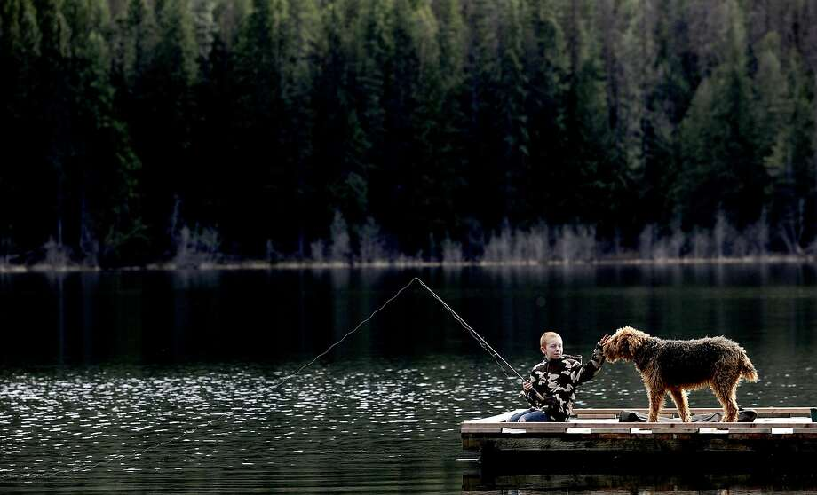 """The indiscriminating angler:""""I want to catch anything that'll bite,"""" 9-year-old Kaden Thompson told a   photographer on Round Lake in Dufort, Idaho. Photo: Kathy Plonka, Associated Press"""