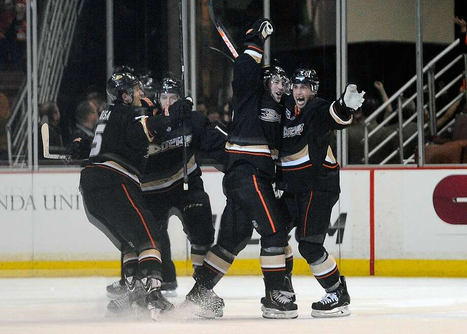 Anaheim's Stephane Robidas (center) celebrates with Andrew Cogliano (7) after scoring the winning goal in overtime. Photo: Kelvin Kuo, Reuters
