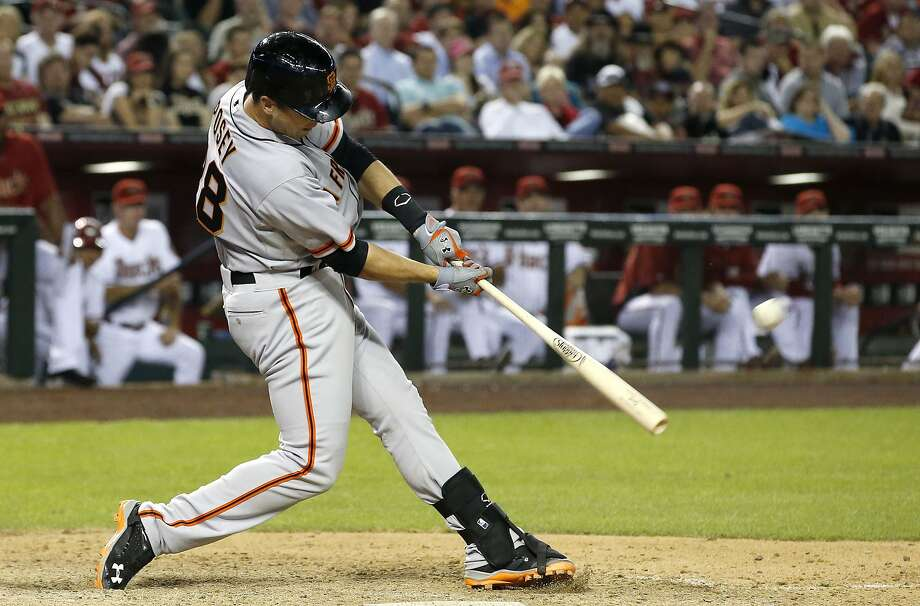 Buster Posey connects for a 2-run homer against the Arizona Diamondbacks in the 2014 opener. Photo: Ross D. Franklin, Associated Press
