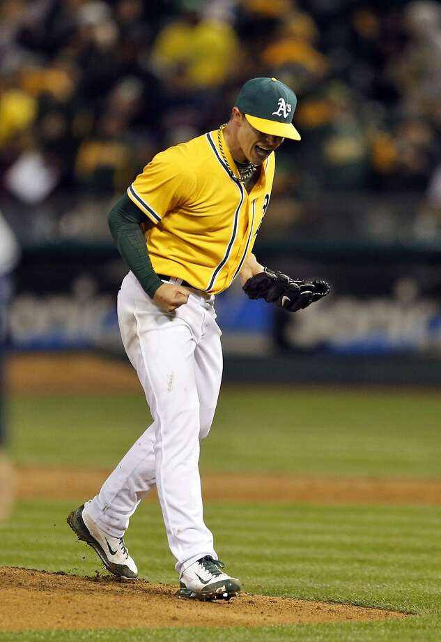 Sonny Gray allows himself a show of emotion after working out of a first-and-third, one-out jam in the sixth inning. Photo: Carlos Avila Gonzalez, The Chronicle
