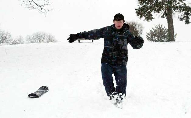 Dylan Barnwell chases his snowboard down the hill at Booth