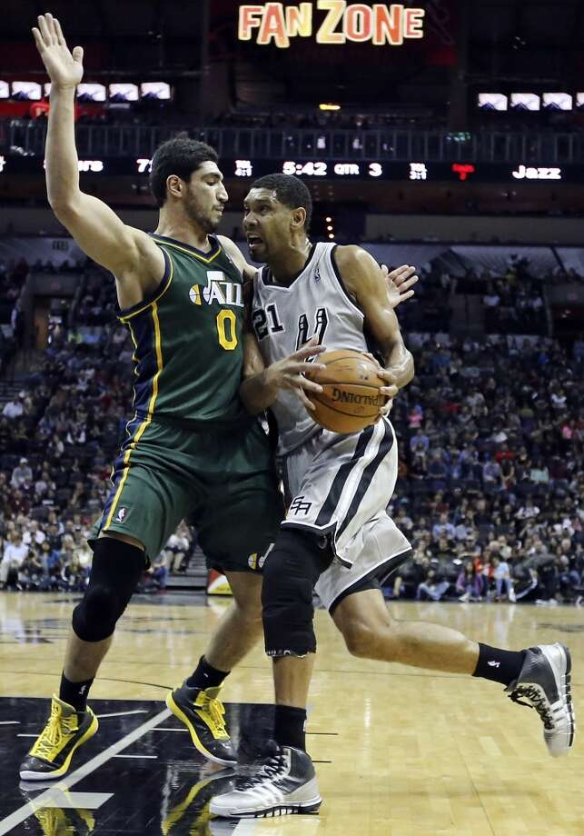 San Antonio Spurs' Tim Duncan looks for room around Utah Jazz's Enes Kanter during second half action Sunday March 16, 2014 at the AT&T Center. The Spurs won 122-104. Photo: Edward A. Ornelas, San Antonio Express-News