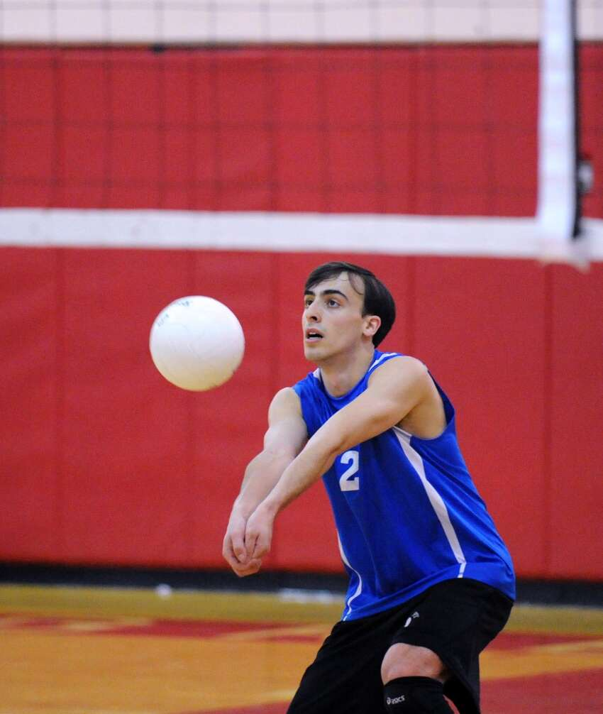 Sam Bryant of Darien High School in action during the boys high school volleyball match between Greenwich High School and Darien High School at Greenwich High School, Tuesday, April 17, 2012.