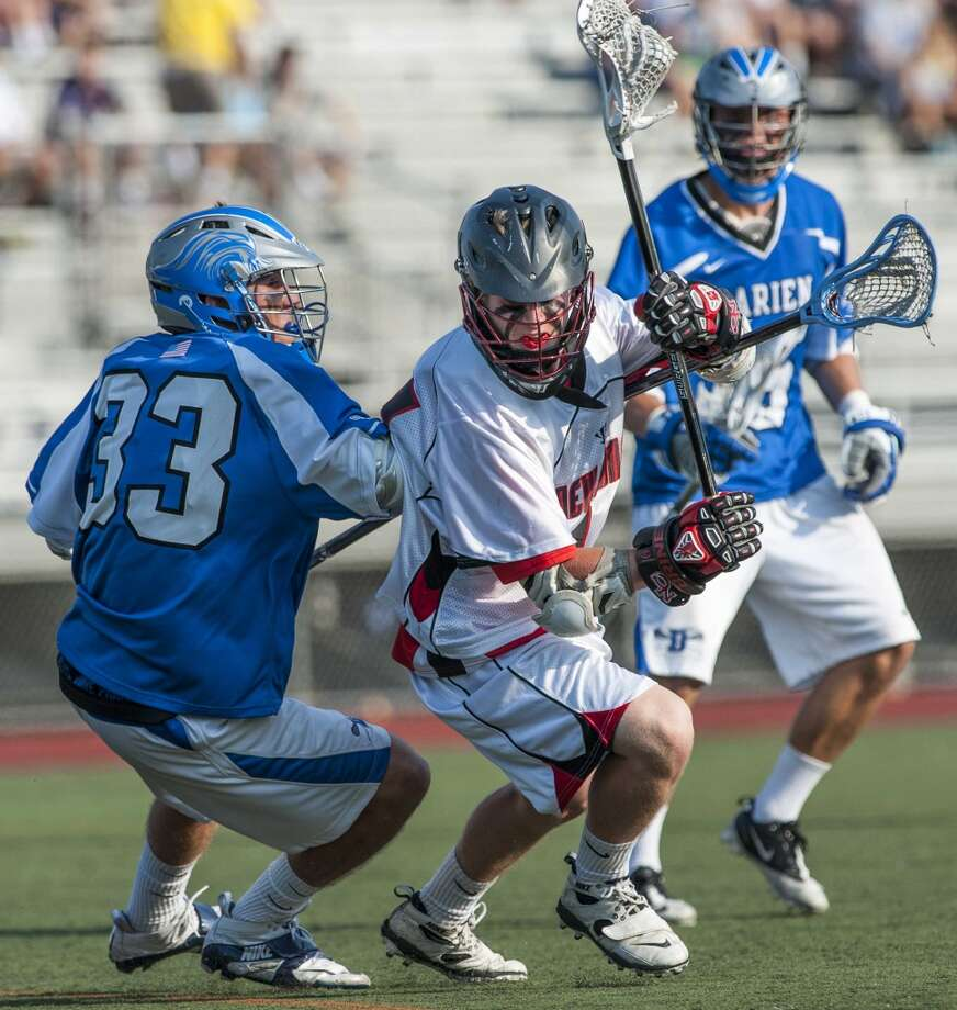 New Canaan high school's Harry Stanton tries to get by Darien high school defenseman, Kyle Gifford, during an FCIAC boys lacrosse semifinal game played at Brien McMahon high school, Norwalk, CT on Tuesday May 21st. 2013. Photo: Mark Conrad