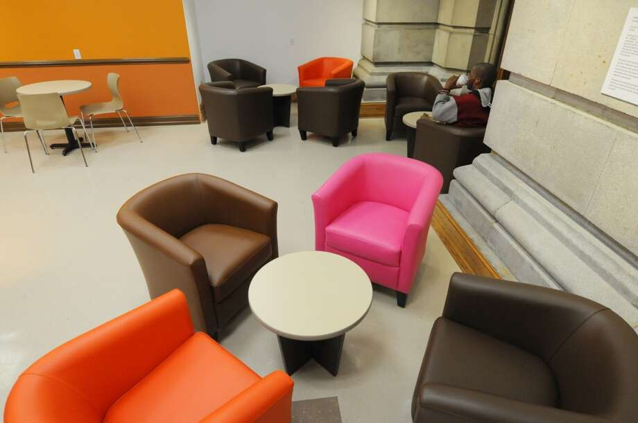 A view of some of the comfortable seating inside the newly opened Dunkin Donuts on the first floor of the Capitol on Monday, March 31, 2014, in Albany, N.Y. On Tuesday morning at 7am, the first 500 guests through the doors will receive a specially printed, $2 Dunkin Donuts rechargeable coffee card, featuring a photo of the Capitol building. The Dunkin Donuts will be open Monday through Friday, from 7am until 6pm.  (Paul Buckowski / Times Union) Photo: Paul Buckowski, Albany Times Union