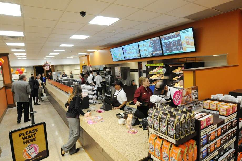 Customers make their way through the line at the newly opened Dunkin Donuts on the first floor of the Capitol on Monday, March 31, 2014, in Albany, N.Y. ÊOn Tuesday morning at 7am, the first 500 guests through the doors will receive a specially printed, $2 Dunkin Donuts rechargeable coffee card, featuring a photo of the Capitol building. ÊThe Dunkin Donuts will be open Monday through Friday, from 7am until 6pm.  (Paul Buckowski / Times Union) Photo: Paul Buckowski, Albany Times Union