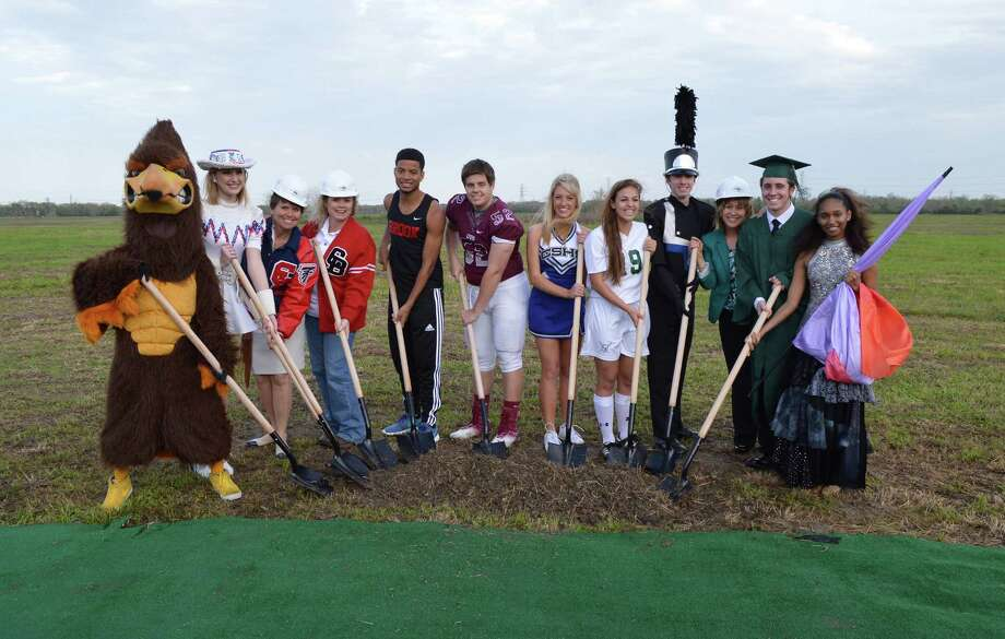 Participating in the groundbreaking are, from left, Falcon mascot Tessa Martin, Falcon Flair Maddie Kuczynski, Clear Lake High School Principal Debra Dixon, Clear Brook High School Principal Michele Staley, Clear Brook track Jamarco Stephen, Clear Creek football Josh Mixon, Clear Springs cheer Haley Kneupper, Clear Falls soccer Maddie Huerta, Clear Springs band Daniel Del Nero, Clear Falls High School Principal Karen Engle, Clear Falls graduate Alex Petty and Clear Creek Color Guard Nelly Rudd. Photo: CCISD Office Of Communications / ©CCISD-2014