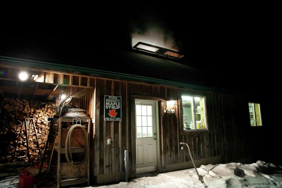 In this March 13, 2014 photo, steam rises from a roof window of the Turtle Lane Maple sugar house in North Andover, Mass. Maple syrup season is finally under way in Massachusetts after getting off to a slow start because of unusually cold weather. (AP Photo/Elise Amendola) ORG XMIT: MAEA107 Photo: Elise Amendola, AP / AP