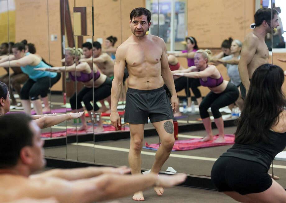 """It's the fountain of youth, is what I tell people,"" says Shane Thornton, center, a Bikram Yoga teacher in San Antonio who competes nationally in executing the poses that make up yoga. Photo: Marvin Pfeiffer / Alamo Heights Weekly / EN Communities 2014"
