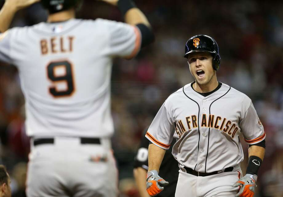 Buster Posey of the San Francisco Giants reacts as he crosses home plate after hitting a two run home-run against the Arizona Diamondbacks during the ninth inning of the Opening Day MLB game at Chase Field on March 31, 2014 in Phoenix, Arizona. Photo: Christian Petersen, Getty Images