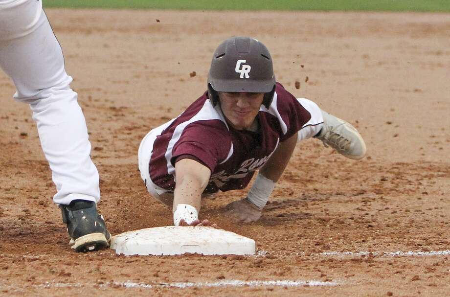 Cinco Ranch's Taylor Jiral made it back safely to first base during a game against Strake Jesuit. Photo: Diana L. Porter, Freelance / © Diana L. Porter