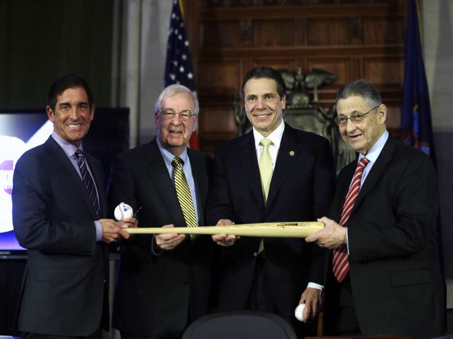 New York Gov. Andrew Cuomo, second from right, Senate co-leader Jeff Klein, D-Bronx, left, Sen. Kemp Hannon, R-Garden City, and Assembly Speaker Sheldon Silver, D-Manhattan, right, hold baseballs and a bat during a news conference and budget bill signing ceremony in the Red Room at the Capitol on Tuesday, April 1, 2014, in Albany, N.Y. The baseballs and bat represent a grand slam budget after four consecutive on-time budgets. (AP Photo/Mike Groll) Photo: Mike Groll, AP