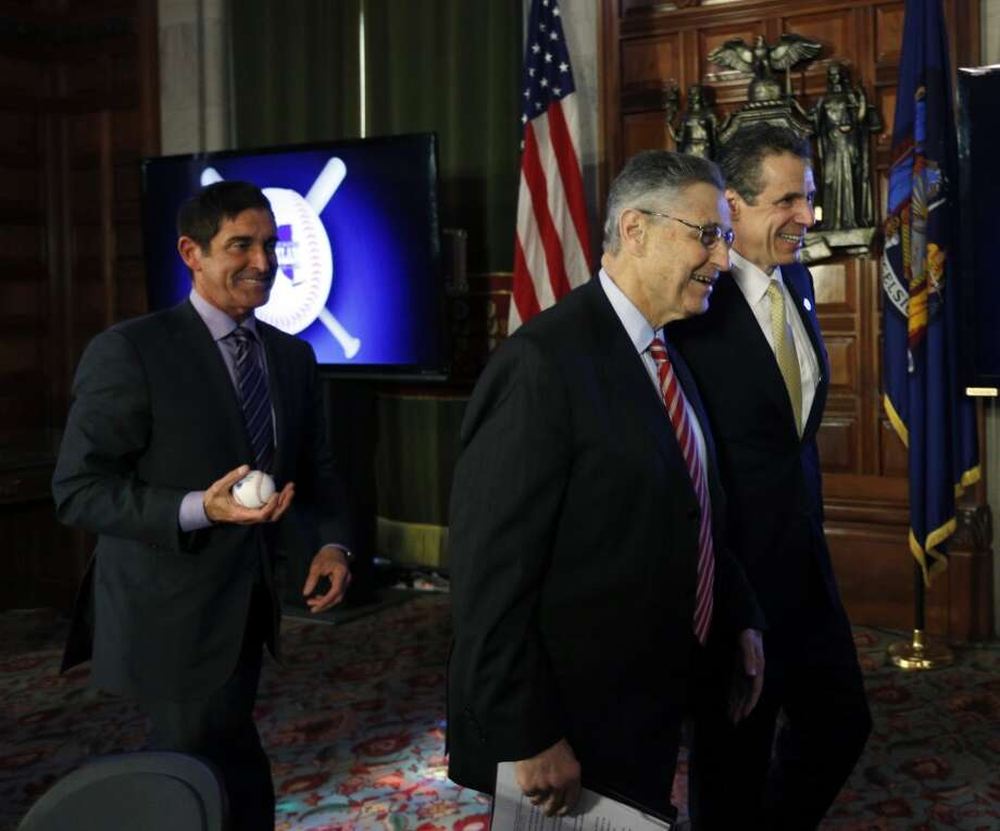 New York Gov. Andrew Cuomo, right, Assembly Speaker Sheldon Silver, D-Manhattan, center, and Senate co-leader Jeff Klein, D-Bronx, leave a news conference and budget bill signing ceremony in the Red Room at the Capitol on Tuesday, April 1, 2014, in Albany, N.Y. (AP Photo/Mike Groll) Photo: Mike Groll, AP