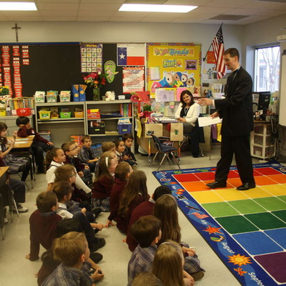 Father Michael Sullivan was among those who spoke at John Paul II Catholic School about vocations.