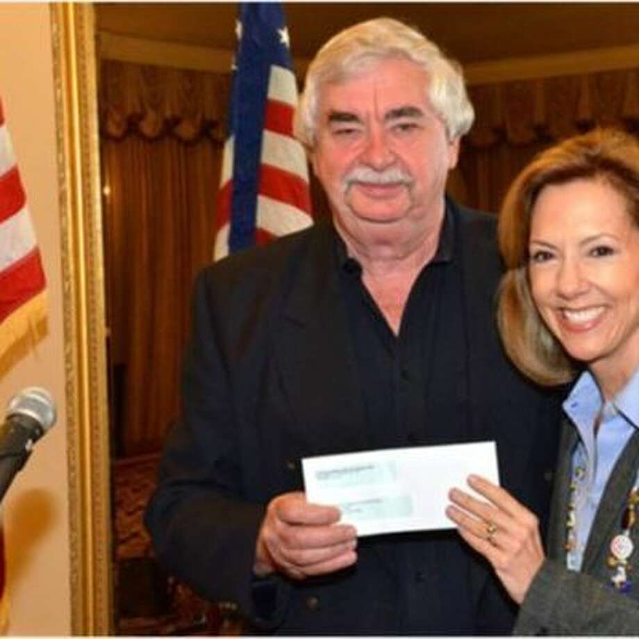 Judge Robert Kern, president of Exchange Club of Sugar Land, presents Ruthanne Mefford a check for $16,570 for Child Advocates of Fort Bend.