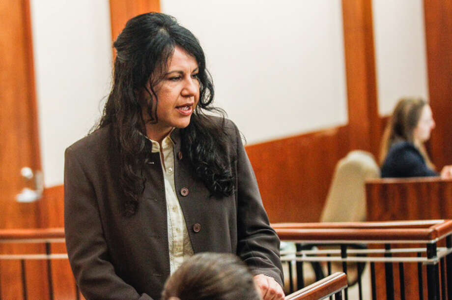 Ana Lilia Trujillo walks into the courtroom for her trial Tuesday, April 1, 2014, in Houston. Photo: Brett Coomer, Houston Chronicle