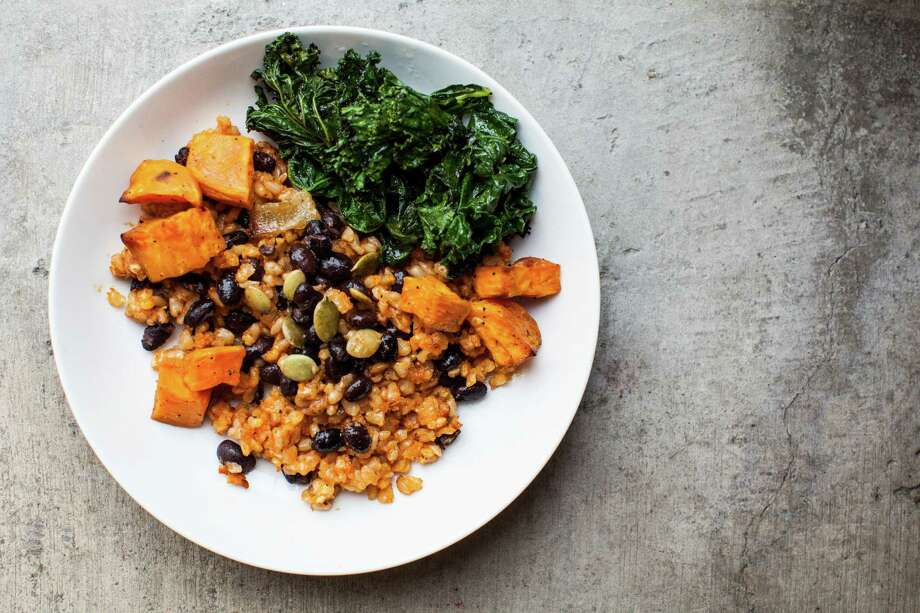 Snap Kitchen offers Grilled Kale Hoppin' John (cumin-scented grilled kale, brown Spanish rice, black beans, toasted pumpkin seeds and roasted sweet potatoes). Photo: Julie Soefer / Julie Soefer