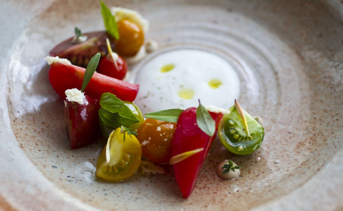 Tomatoes (from Three Sisters Farm) served with bay leaf, pine nut puree, spring herbs with milk foam at Oxheart.