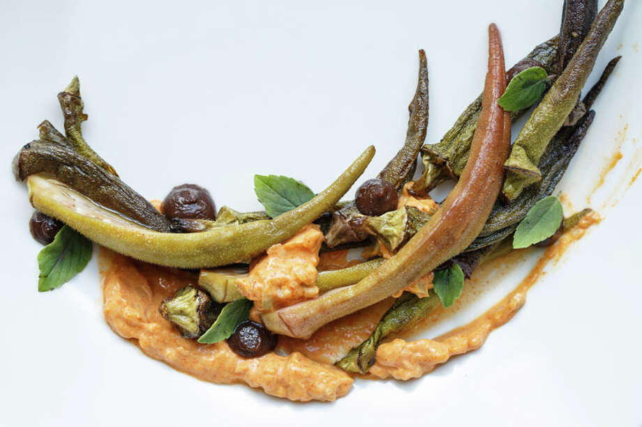 Slowly roasted and pickled okra, with smoked black garlic, creme fraiche, and 'african blue' basil at Oxheart, Photo: Michael Paulsen, Houston Chronicle / © 2013 Houston Chronicle
