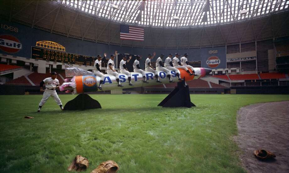 From the April 12, 1965, Houston Post: It is purely symbolic, of course, but Manager Luman Harris hopes to send his Houston Astros into space this season -- or at least to an altitude beyond last year's ninth place finish in the National League. The Astros open the 1965 season Monday night at the Domed Stadium against the Philadelphia Phillies, and carrying the payload will be these nine starters: From left, Bob Bruce, pitcher; John Bateman, catcher; Bob Lillis, shortstop; Jimmy Wynn, centerfield; Bob Aspromonte, third base; Walt Bond, first base; Rusty Staub, right field; Al Spangler, left field, and Joe Morgan, second base. Manager Harris puts the torch to the Astrorocket, bound -- he hopes -- for a higher finish. Photo: Owen Johnson, Houston Post