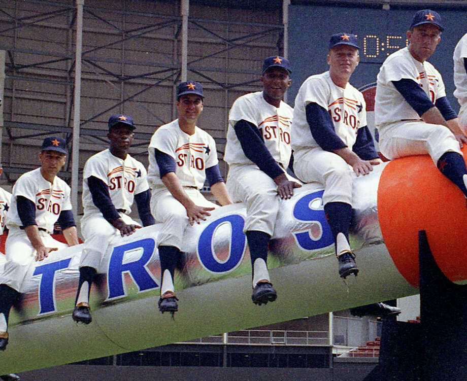 From the April 12, 1965, Houston Post: It is purely symbolic, of course, but Manager Luman Harris hopes to send his Houston Astros into space this season -- or at least to an altitude beyond last year's ninth place finish in the National League. The Astros open the 1965 season Monday night at the Domed Stadium against the Philadelphia Phillies, and carrying the payload will be these nine starters: From left, Bob Bruce, pitcher; John Bateman, catcher; Bob Lillis, shortstop; Jimmy Wynn, centerfield; Bob Aspromonte, third base; Walt Bond, first base; Rusty Staub, right field; Al Spangler, left field, and Joe Morgan, second base. Manager Harris puts the torch to the Astrorocket, bound -- he hopes -- for a higher finish. Photo: Owen Johnson, Houston Post / Houston Chronicle