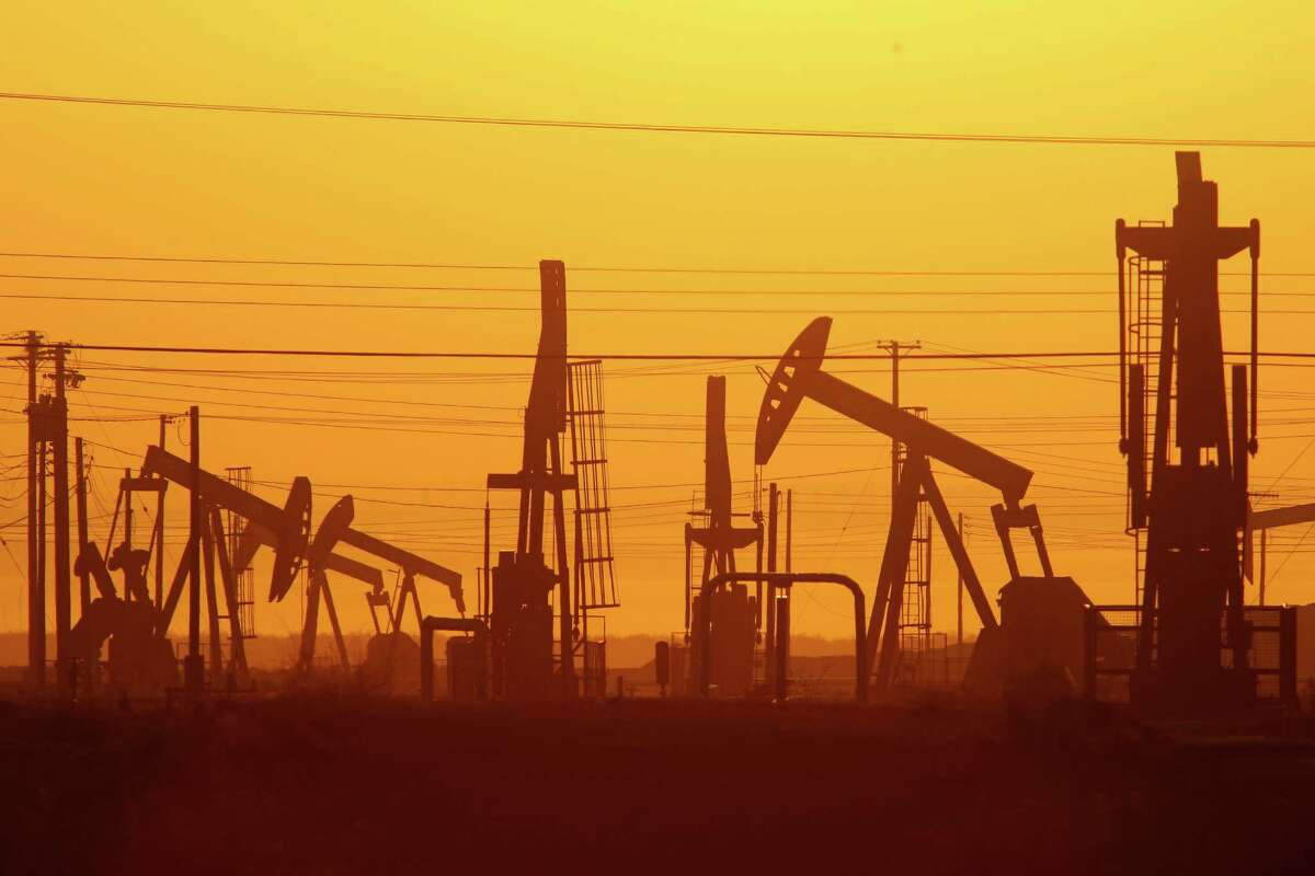 Pump jacks are seen at dawn in an oil field over the Monterey Shale formation where gas and oil extraction using hydraulic fracturing, or fracking, is on the verge of a boom in March 2014 near Lost Hills, Calif.