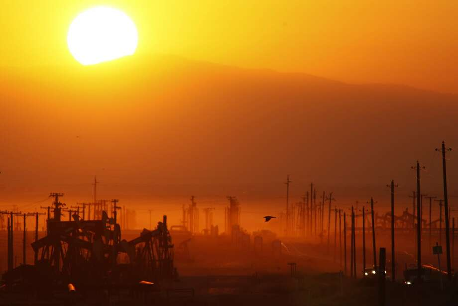 The sun rises over an oil field over the Monterey Shale formation where gas and oil extraction using hydraulic fracturing, or fracking, is on the verge of a boom on March 24, 2014, near Lost Hills, California.  Photo: David McNew, Getty Images