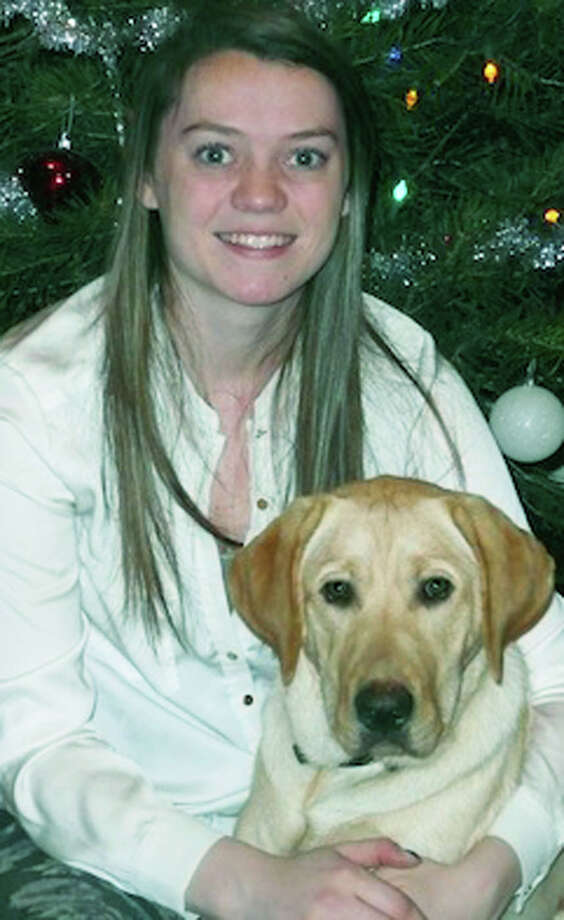 Katelyn Kirkwood of New Milford bonds with Ireland, a Guiding Eyes for the Blind puppy raised by Katelyn's family. March 2014 Photo: Picasa, Contributed Photo / The News-Times Contributed