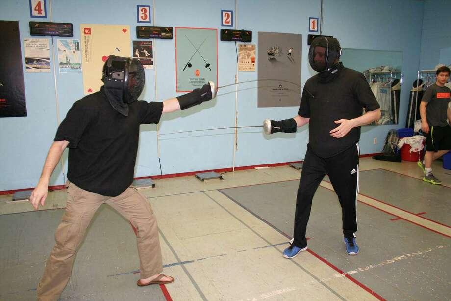 Benoit Bouysset, left, will coach the men's épée fencers, and Andrey Geva will coach the women's épée competitors. Photo: Tom Behrens