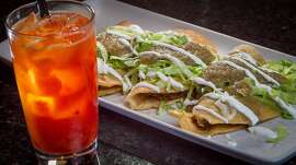 "The Birria Tacos Dorados wi the ""Donkey Show"" cocktail at Rumbo al Sur in Oakland, Calif., is seen on Wednesday, March 26th, 2014."