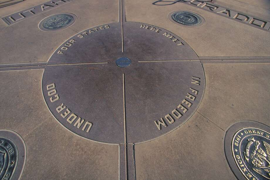 A plaque marks the spot where four states - Arizona, Colorado, New Mexico and Utah - come together. Photo:     VisionsofAmerica/Joe Sohm