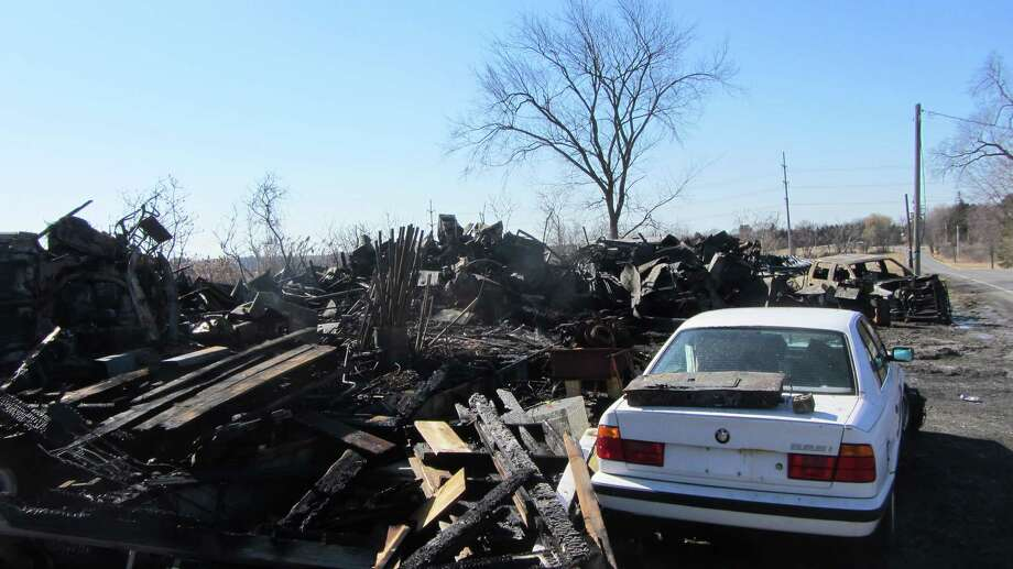 Several cars and car parts were inside a Columbia County barn that was destroyed by fire. (Bob Gardinier / Times Union)