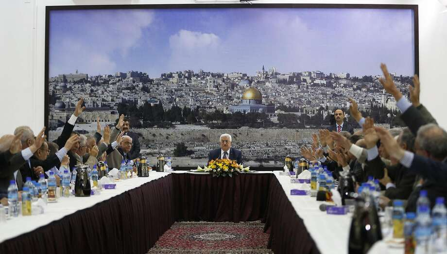 President Mahmoud Abbas (center) presides as Palestinian leaders vote on international conventions. Photo: Mohamad Torokman, Reuters