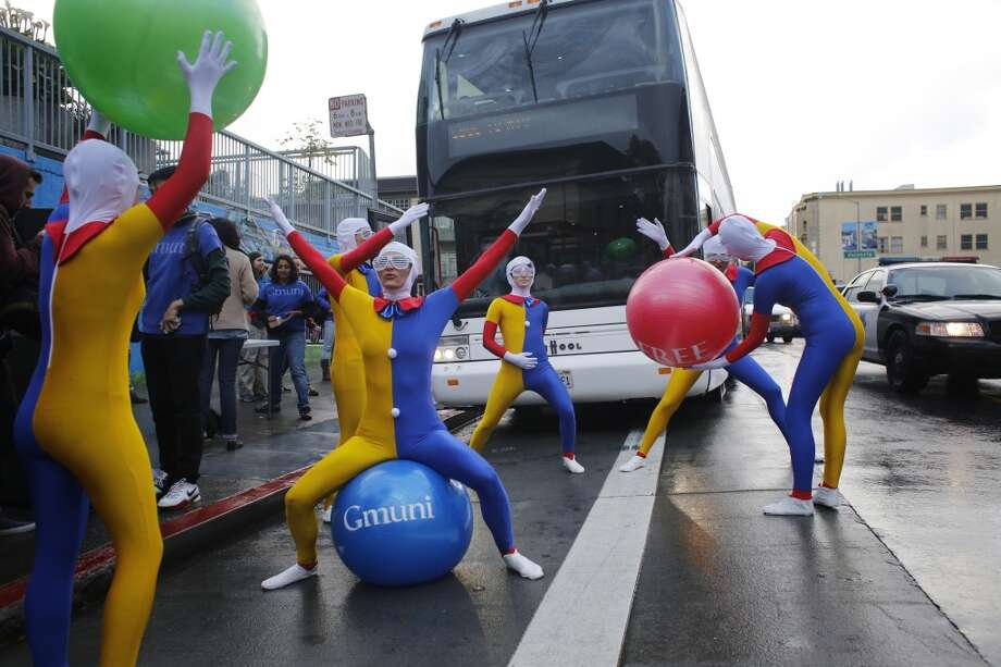"A group of protesters calling themselves the ""Gmuni dancers"" block a Google Bus from moving on 24th Street at Valencia Street on Tuesday April 1, 2014 in San Francisco, Calif. Photo: Mike Kepka, The Chronicle"