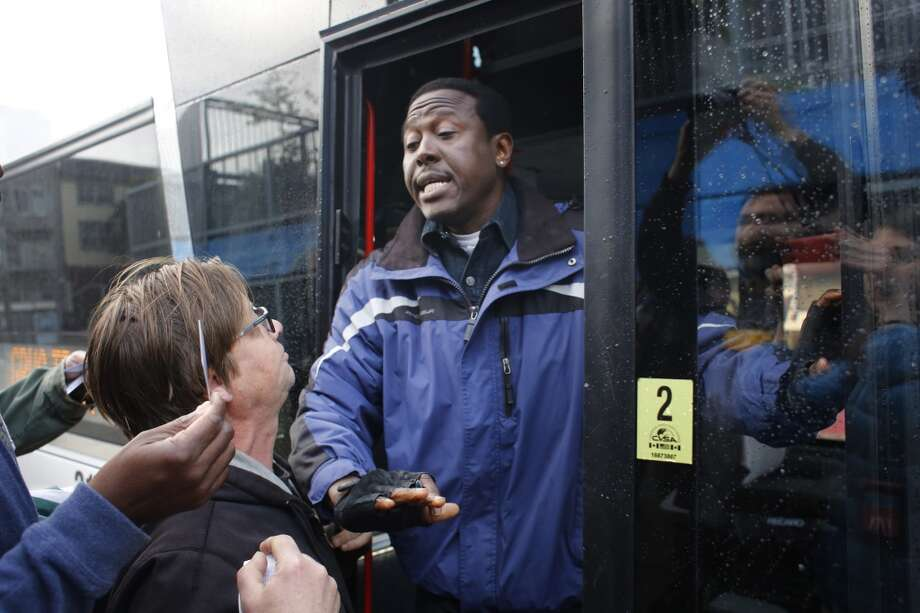 A Google bus driver tries to keep protester Robert Irminger (left) off the bus. Photo: Mike Kepka, The Chronicle