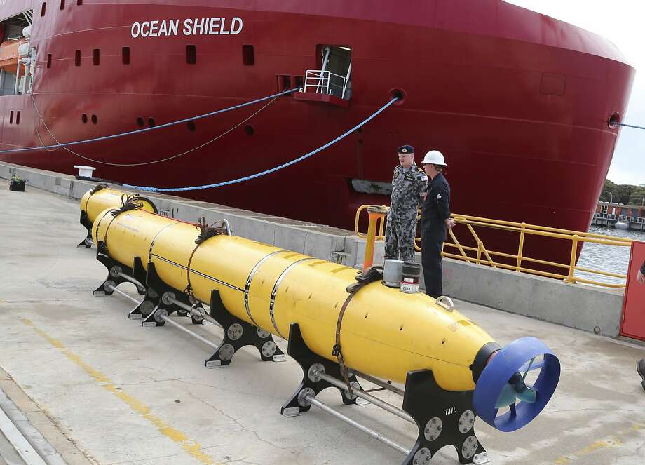 CORRECTS IDENTIFICATION OF EQUIPMENT TO AN AUTONOMOUS UNDERWATER VEHICLE INSTEAD OF A TOWED PINGER LOCATOR -  An autonomous underwater vehicle (AUV) sits on the wharf at naval base HMAS Stirling in Perth, Australia, ready to be fitted to the Australian warship Ocean Shield to aid in the search for missing Malaysia Airlines Flight MH370, Sunday, March 30, 2014. The Australian Maritime Safety Authority, which oversees the search, said the ship will be equipped with a black box detector ? the U.S. Navy's Towed Pinger Locator ? and the AUV, as well as other acoustic detection equipment. (AP Photo/Rob Griffith) Photo: Rob Griffith, Associated Press
