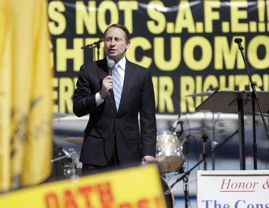 Republican gubernatorial candidate Rob Astorino speaks during a gun rights rally at the Empire State Plaza on Tuesday, April 1, 2014, in Albany, N.Y. Activists are seeking a repeal of a 2013 state law that outlawed the sales of some popular guns like the AR-15. The law championed by Gov. Andrew Cuomo has been criticized as unconstitutional by some gun rights activists. (AP Photo/Mike Groll) Photo: Mike Groll, AP