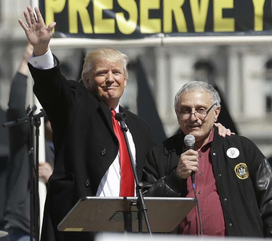 Donald Trump, left, and Carl Paladino, who ran for governor of New York as a Republican in 2010, speak during a gun rights rally at the Empire State Plaza on Tuesday, April 1, 2014, in Albany, N.Y. Activists are seeking a repeal of a 2013 state law that outlawed the sales of some popular guns like the AR-15. The law championed by Gov. Andrew Cuomo has been criticized as unconstitutional by some gun rights activists. (AP Photo/Mike Groll) Photo: Mike Groll, AP